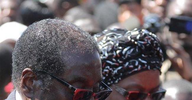 Zimbabweans mourn general, top power broker