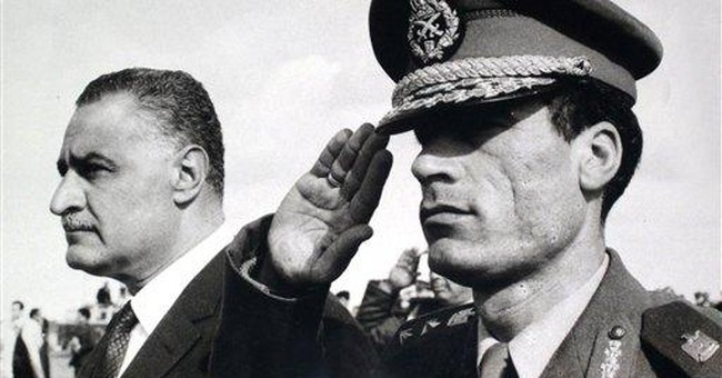 Libya's bizarre leader Gadhafi defiant to end