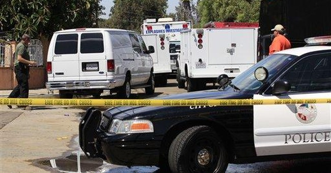 Shot San Diego County officer talking, sitting up