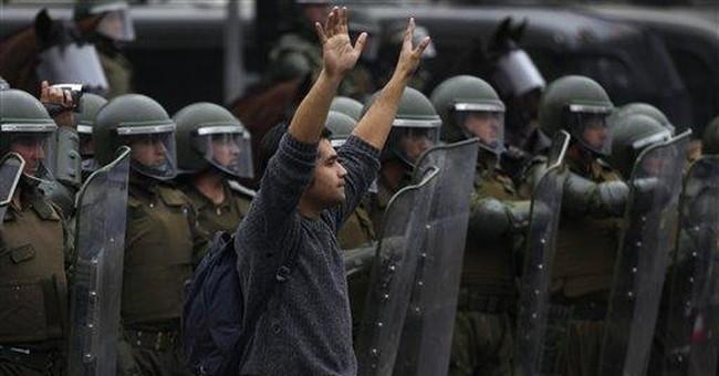 Chile leader wants talks; 1 dead, 1,400 arrests
