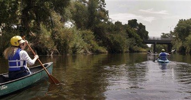 In Los Angeles, paddling down a concrete river