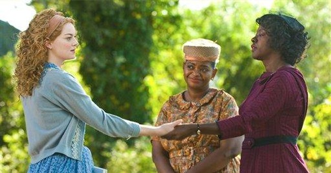 'The Help' reigns again over storm-soaked weekend