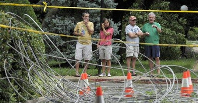 Crews rush to restore power after Irene slams East