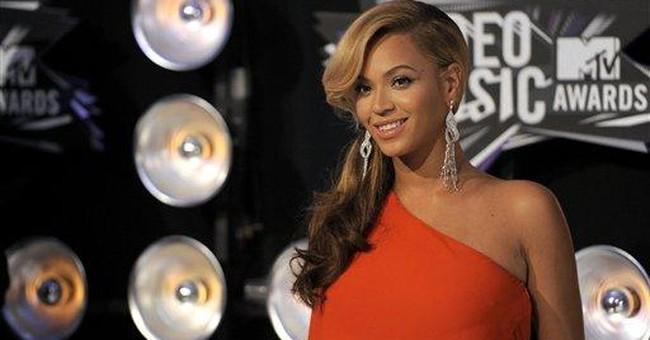 Beyonce's baby, Gaga's alter-ego spice up VMAs