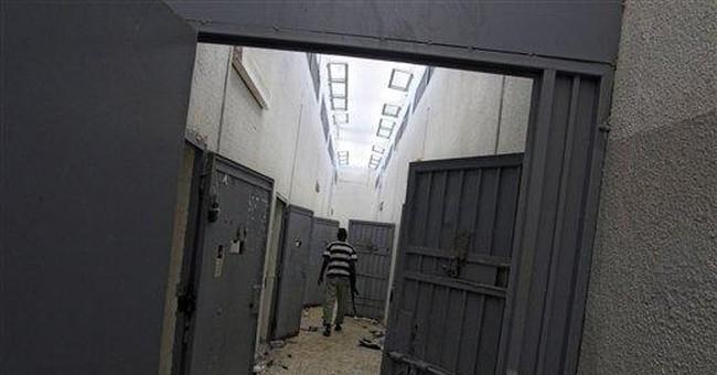 Liberated inmates tell of 'dark age' under Gadhafi