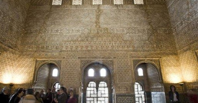 Tourist carves initials on Spain's Alhambra