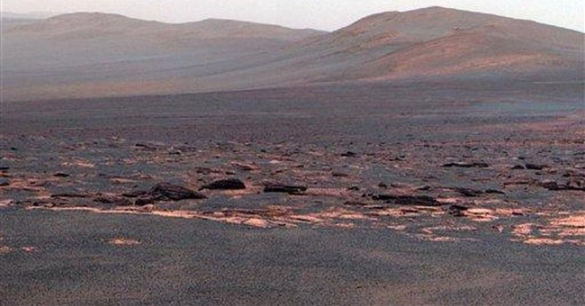 Mars rover Opportunity examining rocks at new site