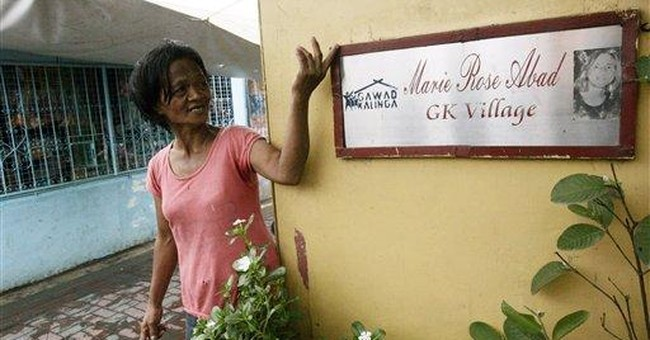 Poor Filipinos have 9/11 victim to thank for homes