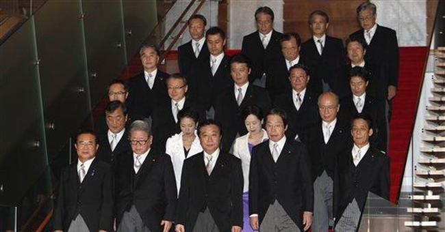 Japan's PM picks fresh faces, unifiers for Cabinet