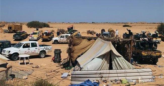 Libya rebels focus on tribal city as Gadhafi haven