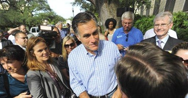 Romney, Perry wage GOP fight over business records