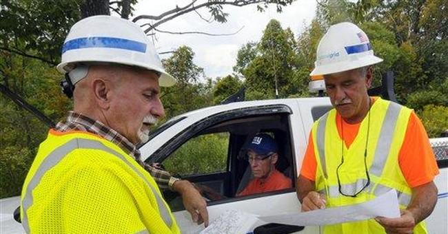 Power companies go on defensive in darkened East
