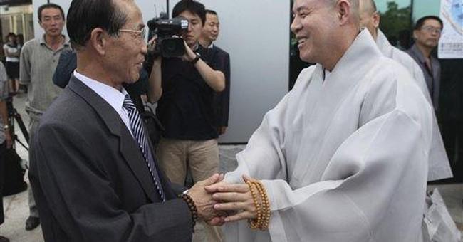 SKoreans visiting North Korea for Buddhist service