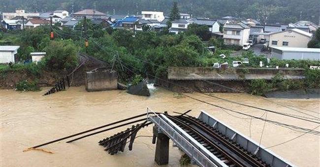 Typhoon dumps record rain on Japan, killing 20