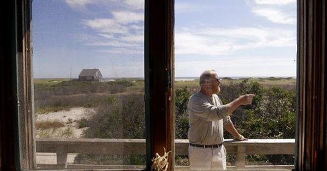 Feds: Cape Cod island cottages endangered, must go