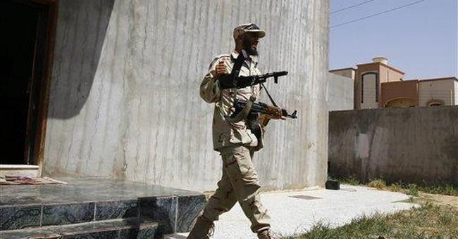 Ex-Libya rebels search homes of Gadhafi loyalists