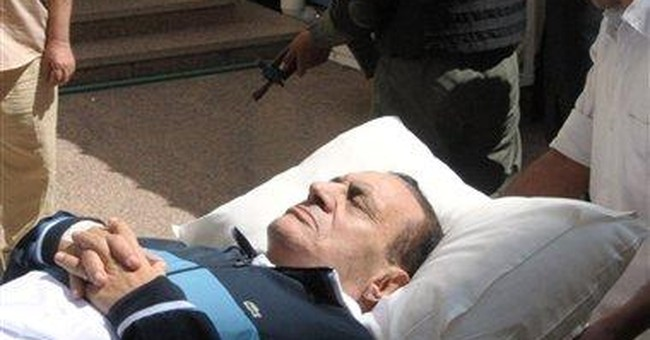 Witness in Mubarak trial says he objected to force