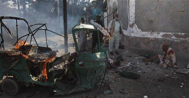 Twin suicide blasts kill 23 people in Pakistan