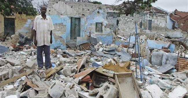Somalis slowly return to ruined homes in capital