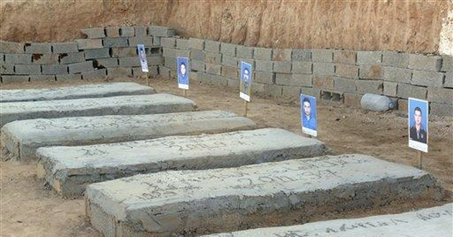 Libyans find mass grave, bodies of slain detainees