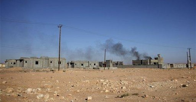 Libya fighters' push stalled by Gadhafi troops