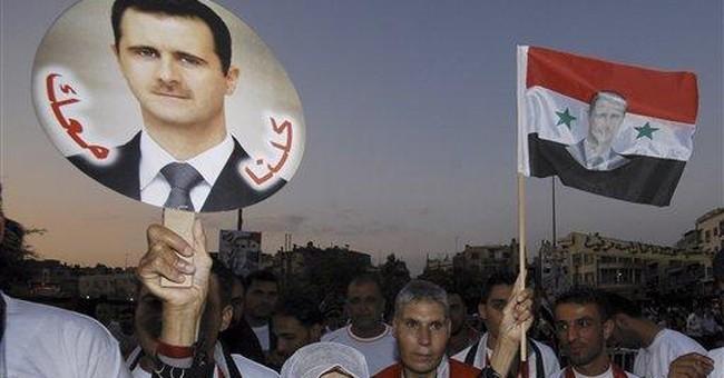 Syrian forces raid neighborhoods near capital