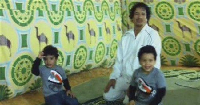 Gadhafi home video shows him clowning with kids