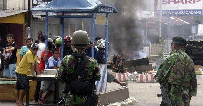 Indonesia sends troops to quell sectarian clashes