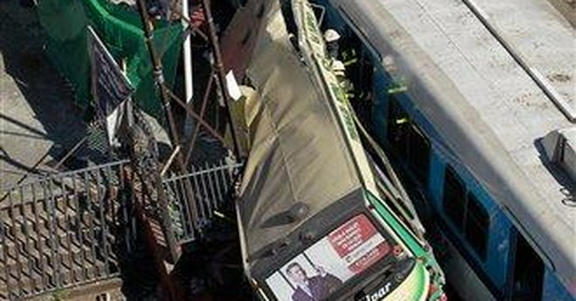 Argentines point fingers in deadly bus-train crash