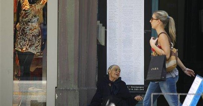 French, Greek, German leaders discuss Greek crisis
