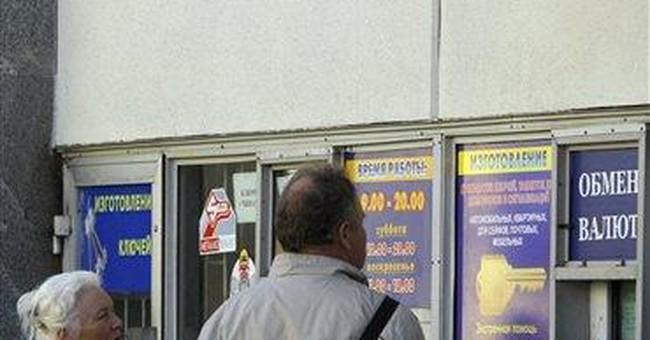 Belarus currency plummets after free float