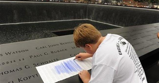 At 9/11 memorial, mourners take home rubbings