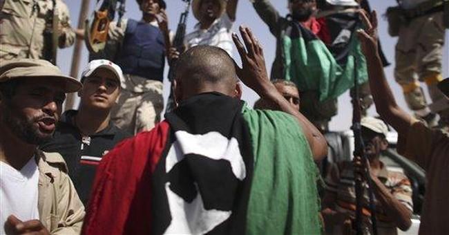 Gadhafi loyalists beat back assault on strongholds