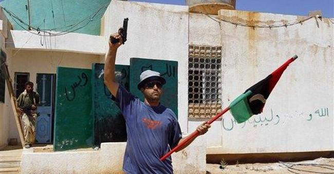 Libyan fighters inch forward in Gadhafi hometown