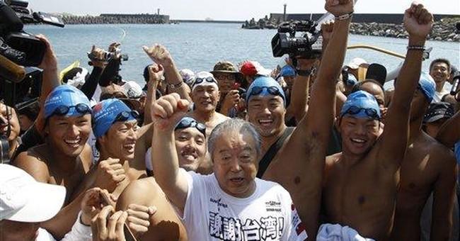 6 Japanese swim to Taiwan to show quake gratitude