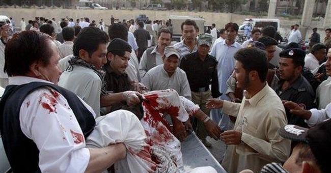 Gunmen attack Shiite pilgrims in Pakistan; 26 dead