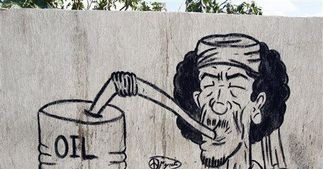 Libyan graffiti artists make fun of Gadhafi