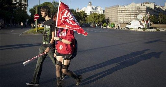 Spain teachers strike for 2nd day over staff cuts