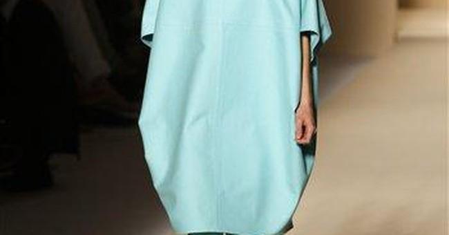 Milan fashion features feminine pleated styles