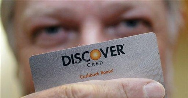 Discover 3Q profit more than doubles, card use up