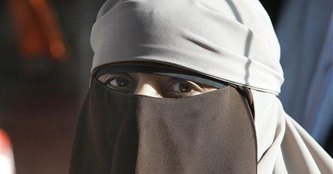 Muslim women flout French ban of veil