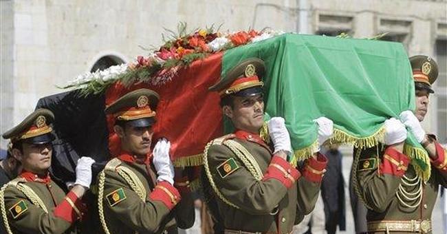 Distraught followers bury slain Afghan ex-leader