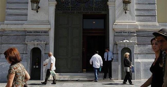 Moody's downgrades 8 Greek banks