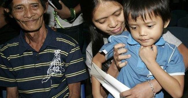 2 Filipino maids for Gadhafi relative return home