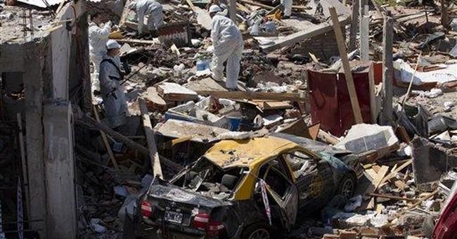 Argentine blast kills woman, hurts 9; gas blamed