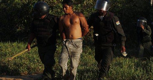 Bolivian police break up anti-highway march