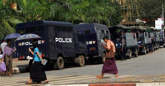 Myanmar police stand by as protesters test limits