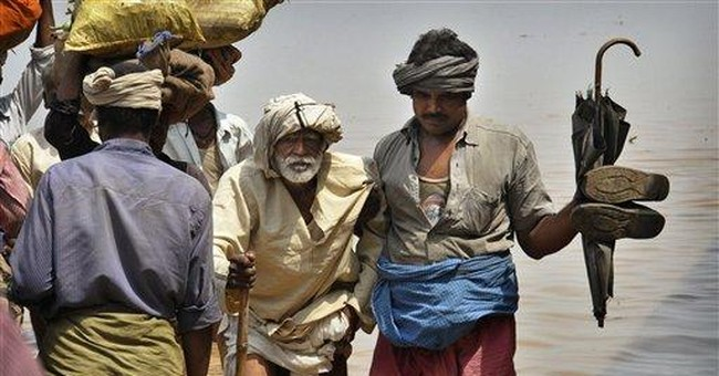 Tens of thousands stranded by floodwaters in India