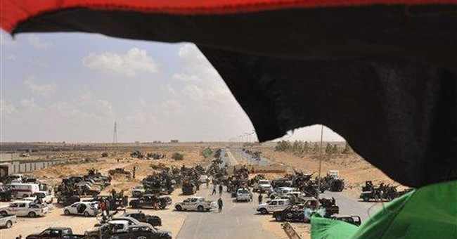 Libya's new rulers believe Gadhafi hiding in south