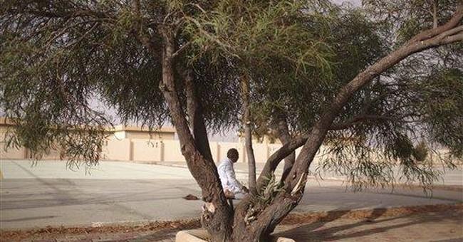 Destroyed school raises questions for Libyans
